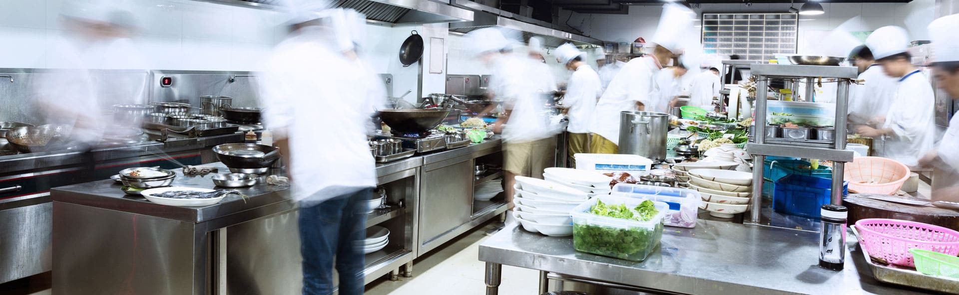 chefs busy cooking in a commercial kitchen